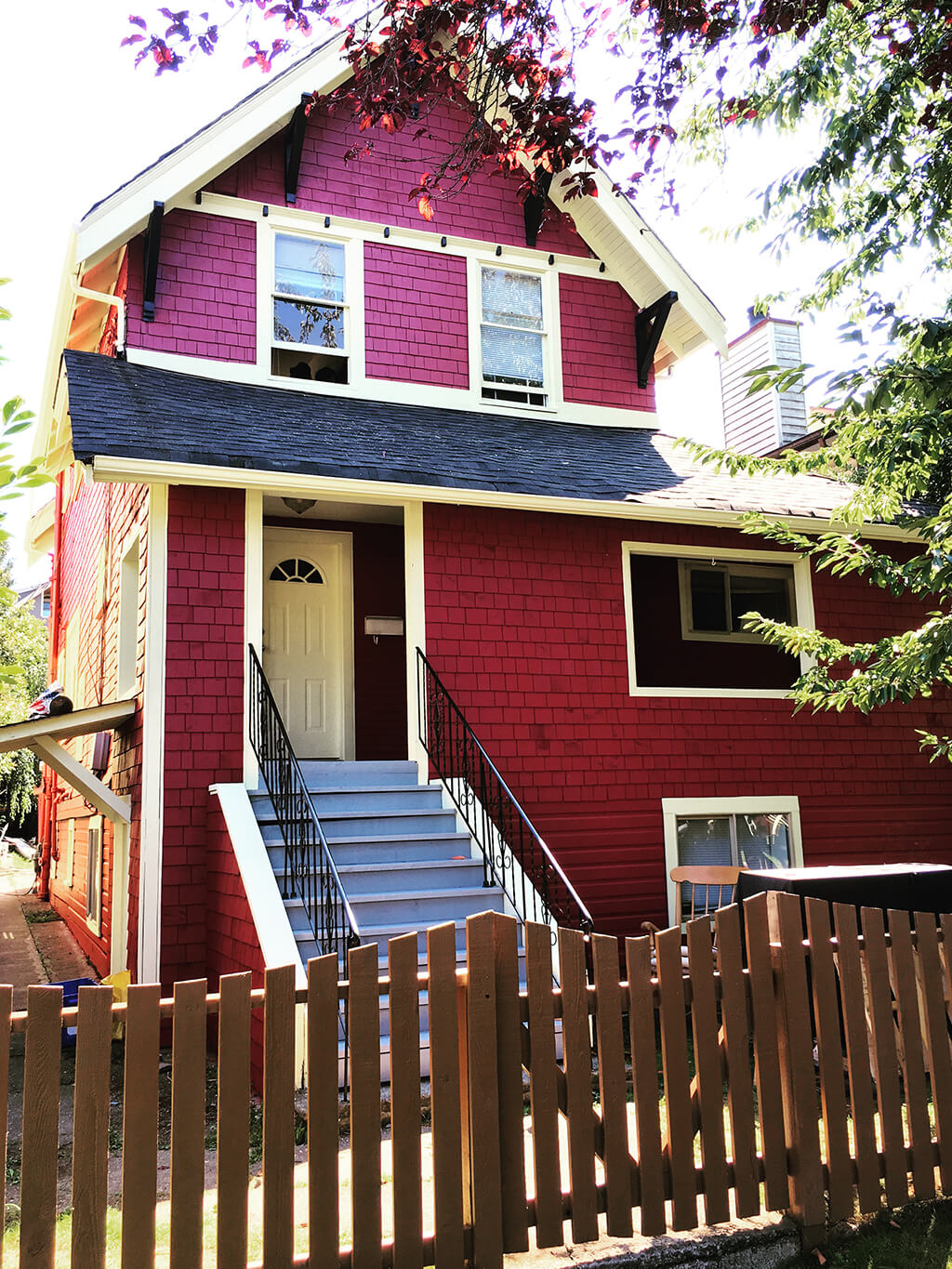 a two-storey house painted in red by cypress painter