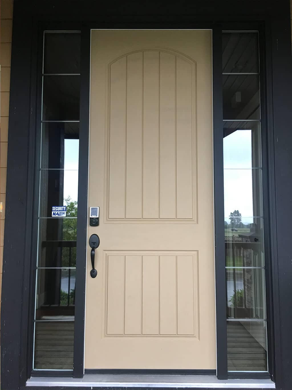 a white painted door with dark navy frame