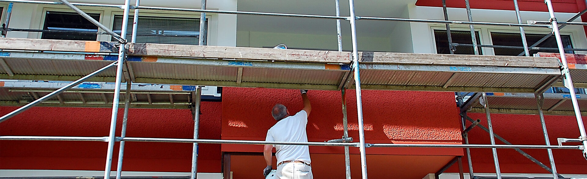 a cypress painter painting the exterior of a commercial building