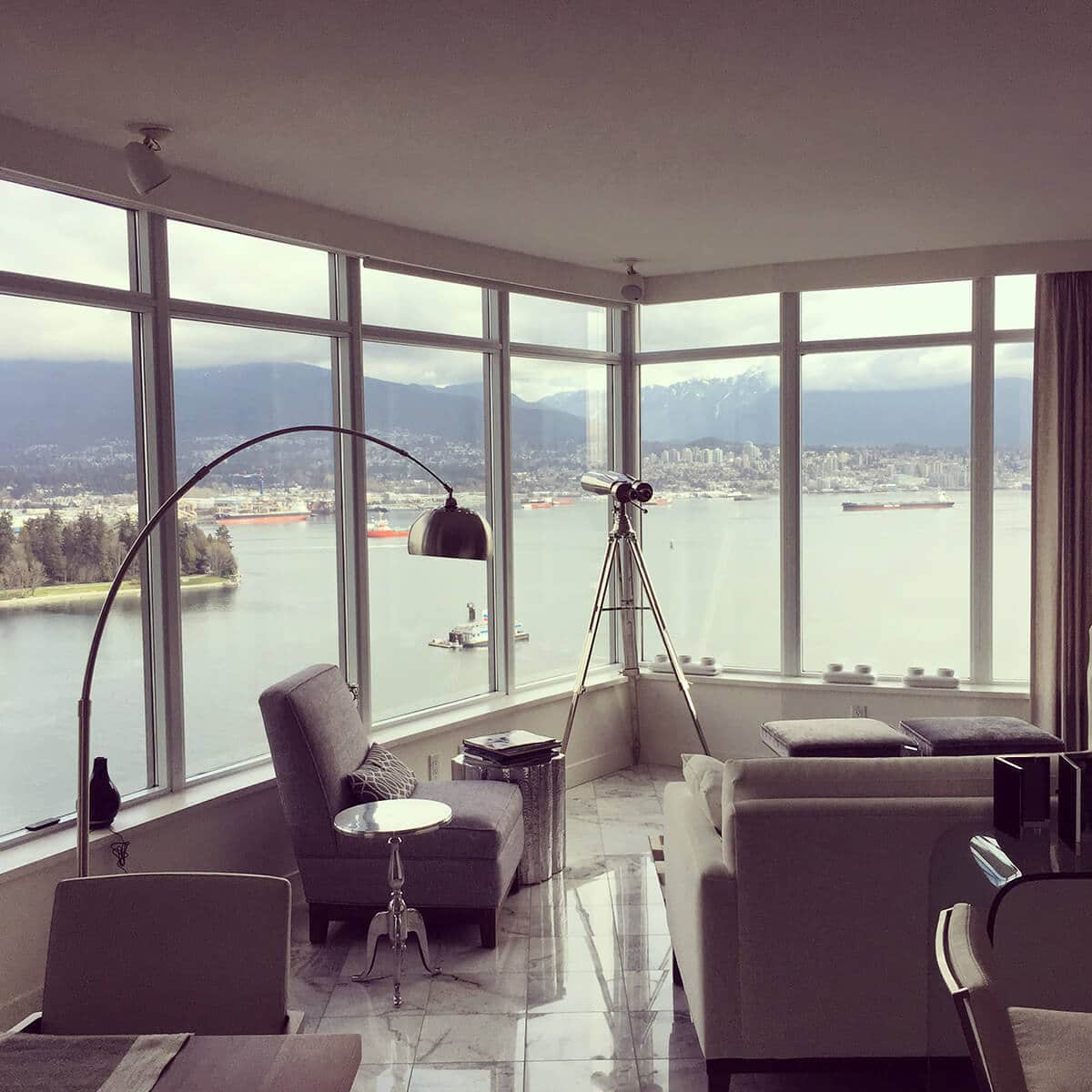 Full-height glass window with views from a condo