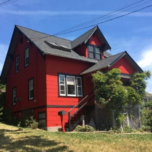 a newly renovated house with red wall painted by Cypress Painting