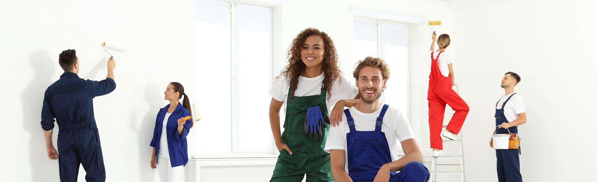 Team of professional painters working indoor